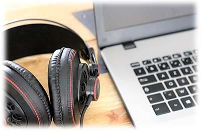 headphones next to a laptop